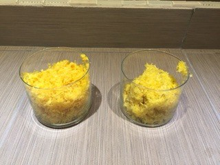 Conventional lemon zest vs. organic lemon zest in clear glasses.