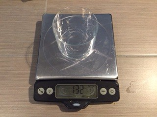 Drinking glass weighed on a food scale.